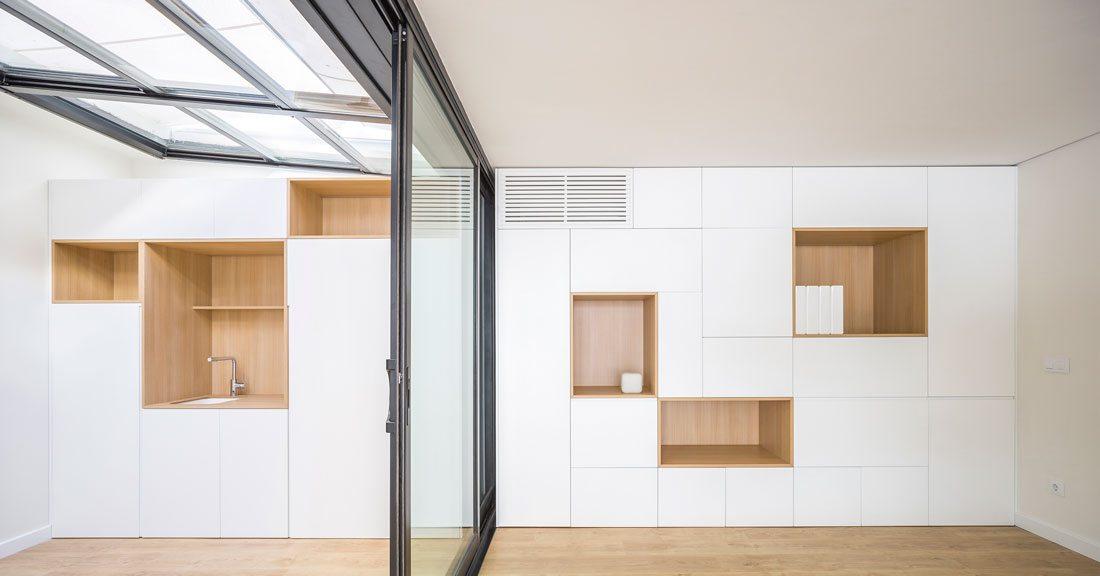 Interiorismo-valencia-reforma-adencia_de_viajes. mobiliario-lacado-blanco-apertura-push.